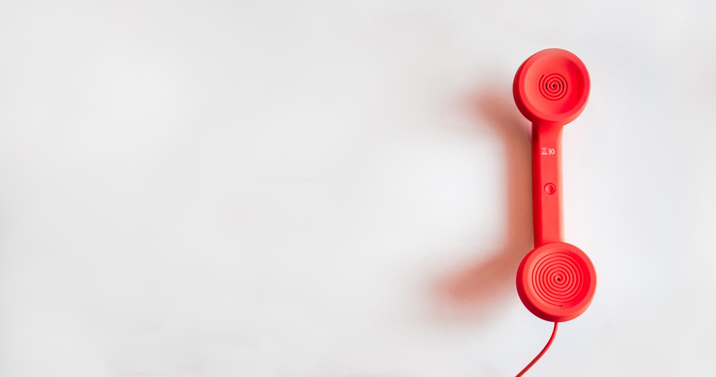 A red corded phone